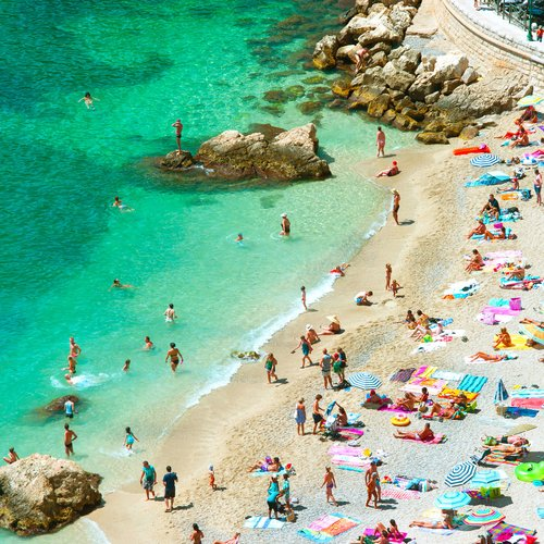 Beach of the Cote d'Azur with Tourists - France Honeymoon Packages