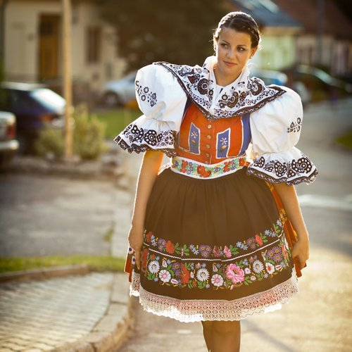 keeping tradition alive , young woman in a richly decorated ceremonial folk dress