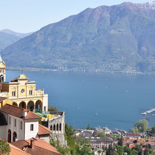 medieval monastery on the rock overlook lake maggiore, switzerland