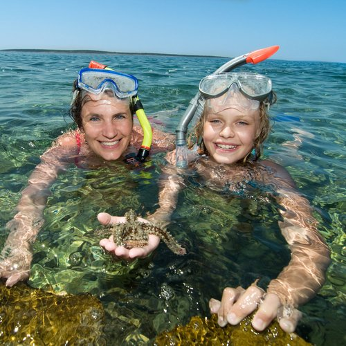 mother and daughter snorkeling in adriatic sea