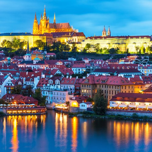 scenic summer evening panorama of the old town architecture with vltava river and st.vitus cathedral in prague