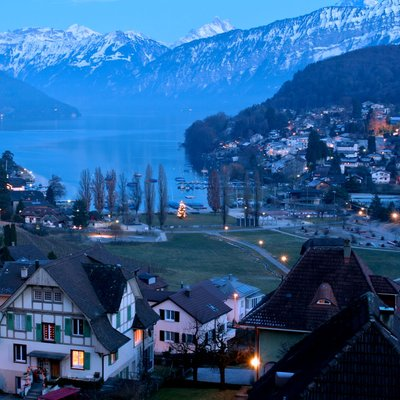 spiez castle and alps night scene switzerland(header )