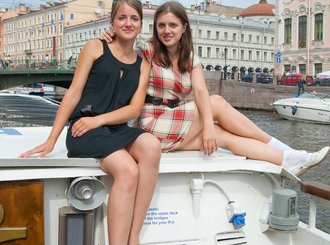 young girls during boat trip at st. petersburg